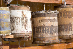 Old wooden prayer wheel in Ladakh, India. Stock Photo