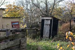 Old wooden privy stock photos