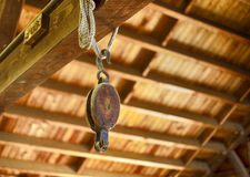 Old wooden pulley hanging in a boat builders shop Royalty Free Stock Photo