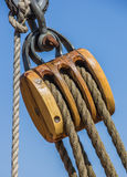 Old wooden pulley on a ship in Lubeck Stock Photos