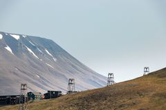 Old wooden pylons for coal-transport carts cables at the edge at Longyearbyen, Svalbard stock images