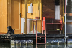 Old Floating Weekend Wooden Raft Hut On Sava River Detail - Belgrade - Serbia. Photograph represents detail of an old, handmade wooden hut, placed among many Stock Photo