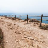 Old wooden railings on Cabo da Roca. Westernmost point Portugal and Europe Royalty Free Stock Image