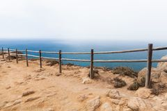 Old wooden railings on the edge of Cabo da Roca. Westernmost point Portugal and Europe Stock Photography