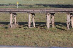 Wooden Rail Bridge. An old wooden railway bridge in the countryside.  The railway bridge stands high and is able to keep out of the water in times of flood Royalty Free Stock Images