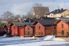 Old wooden red barns, March day. Porvoo, Finland. Old wooden red barns on a sunny March day. Porvoo, Finland royalty free stock photos