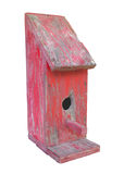 Old wooden red birdhouse isolated. Stock Image