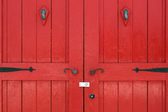 Old wooden red door Stock Photography