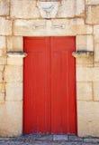 Old wooden red door, Portugal. Stock Photos