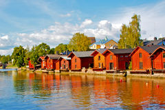Old wooden red houses on the river coast in Porvoo, Finland. Stock Photography