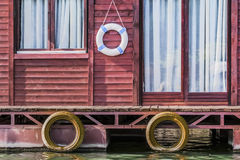 Old Wooden Red Raft Weekend House On Sava River - Detail. Photograph represents detail of an old, handmade weekend leisure wooden raft hut, placed among many Royalty Free Stock Photos