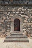 Old wooden Renaissance castle doors. From Castillo de San Gabriel (Castle of the Saint Gabriel), Arrecife, Lanzarote, Canary Islands, Spain Royalty Free Stock Photo