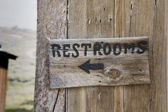 Restroom Sign. An old wooden restrooms sign Stock Images