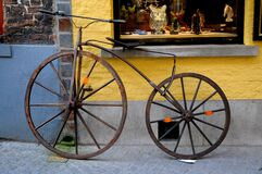 Wooden retro bike in front of a shop