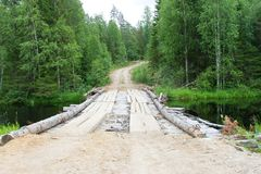 Old wooden road bridge over a forest river. Northern Russia, Karelia Stock Image
