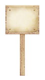 Old wooden road sign with nailed paper sheet Royalty Free Stock Photography