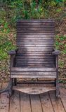 Old wooden rocking chair in a public park royalty free stock photography