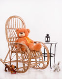 Old wooden rocking chair with toys Stock Photos