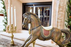 Old wooden rocking horse near the fireplace Stock Images