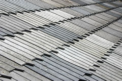 Old  wooden roof. A stock photo of  an old roof of a house made of  grey  wooden tiles Stock Photography