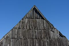 Old wooden roof against the blue sky stock photo