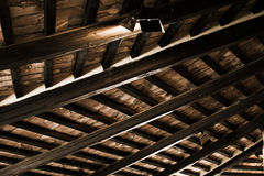 Old wooden roof. An old wooden roof with a lamp Stock Photography