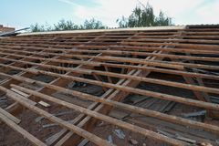 Old wooden roof under repair, roofing dismantling and renovation.  Stock Photo