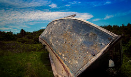 Old wooden rotting boat. On the coast of prince edward island Royalty Free Stock Photography
