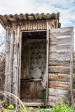 Old wooden rotting toilet in the village Stock Photos