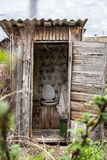 Old wooden rotting toilet in the village Royalty Free Stock Photos