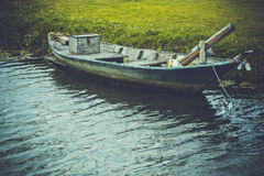 Old wooden rowboat in rerto style Stock Image