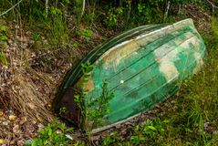 Old wooden rowing boat on the shore of the Saimaa lake in Finland - 13 stock photo