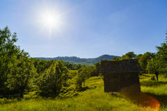 Old wooden ruin house in the mountains of Fagaras Mountains in R. Omania Royalty Free Stock Image