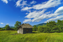 Old wooden ruin house in the mountains of Fagaras Mountains in R Stock Images