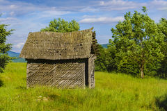 Old wooden ruin house in the mountains of Fagaras Mountains in R Stock Image