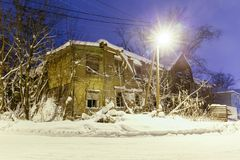 Old wooden ruined barracks at winter night Royalty Free Stock Photos