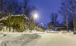 Old wooden ruined barracks at winter night Stock Photography