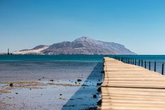 Old wooden ruined bridge on the way to Tiran Island. Red Sea, Egypt Royalty Free Stock Image