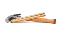 Old wooden rule and hammer. An old wooden rule and wooden handled hammer as used by carpenters in years past, shot in studio over a white background Royalty Free Stock Photo