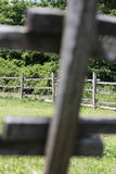 Old wooden rural corral fense in meadow. Closeup of wooden fence on a corral farmland rural scene. Shallow depth of field Royalty Free Stock Photo