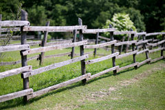 Old wooden rural corral fense in meadow. Old wooden corral fence in meadow rural scene bokeh mood Royalty Free Stock Photo