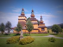 Old wooden Russian orthodox church. Beautiful wooden Greek orthodox church with three towers in Krempna in podkarpackie region in southern Poland sorrounded by Stock Photography