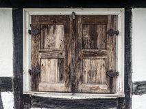Rustic window shutters. Old wooden rustic window shutters Stock Photography