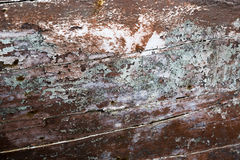 Old wooden rusty boat paint spilled surface closeup background Stock Photos