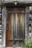 Old wooden rusty cabin door with antique locke. Royalty Free Stock Images