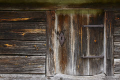 Old wooden rusty cabin door with antique locke. Royalty Free Stock Image