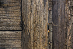 Old wooden rusty wall. Three rusty nails in a wooden wall Royalty Free Stock Photos