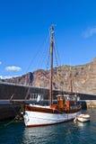 Old Wooden Sailboat in Puerto de Santiago Royalty Free Stock Photo