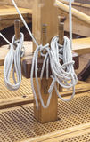 Old wooden sailboat ropes detail. Selective focus royalty free stock photos