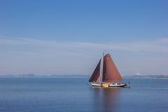 Old wooden sailing boat on the Ijsselmeer near Hoorn Stock Images